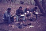 Scout camp leaders eating rice