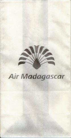 Air Madagascar Airsickness Bag: Silver Travelers' Palm Logo