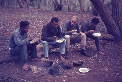 Scout camp leaders eating rice: Ambositra